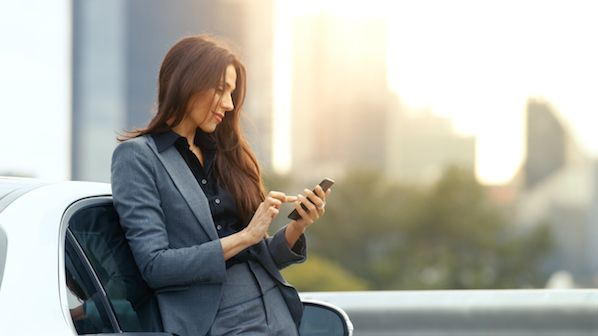 Business woman with iphone