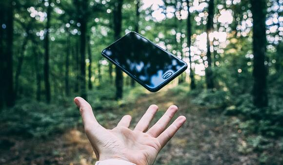 Photo-by-Stanislav-Kondratiev-on-Unsplash-throwing-iphone-in-forest-1024x599